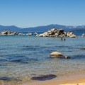 Granite boulders extend offshore at Speedboat Beach, doubling as picture-perfect sunning rocks and swimming platforms.- Speedboat Beach