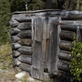An old miner's cabin at the Money Prospect about 2 miles up the trail to Browns Lake.- Little Queens River + Scenic Lake
