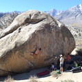Gabe Villanueva on Smooth Shrimp Boulder V6.- Buttermilk Country Rock Climbing