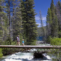 During spring and early summer when the high country is still snowbound and creeks are still dangerous to cross, this bridge over the inlet of Redfish Lake Creek is a nice option.- Redfish Inlet Hikes
