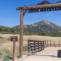 The sign at the trailhead frames Iron Mountain.- Iron Mountain