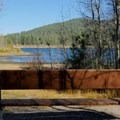 There are many benches around the lake for admiring the view.- Spooner Lake Loop Hike