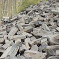 Piles of fractured columnar basalt at the foot of Devils Postpile.- Devils Postpile National Monument