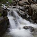 Eureka Creek cascades over shaded rocks.- Eureka Gulch
