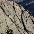 Enjoying beautiful hand cracks on easy slabs to the summit of Old Decker Peak.- Saddleback Lakes