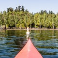The south end of Seward Park. A bouy displays the posted speed limit.- Seward Park Sea Kayaking
