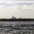 Looking at the Seattle Skyline from the waters off of Seward Park.- Seward Park Sea Kayaking