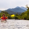Kayaking down the Little Wenatchee River. Haze from the nearby Carlton Complex Fires is visible.- Lake Wenatchee Sea Kayaking
