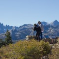 Visitors look out to the Minarets and Ritter Range.- Minaret Vista