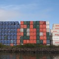 Shipping containers line the banks of the Duwamish Waterway.- Duwamish Waterway Sea Kayaking