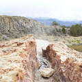 Steam pours off of the source of Travertine Hot Springs.- Travertine Hot Springs