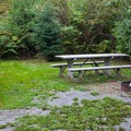 Cabin picnic table at Wallace Falls Campground.- Wallace Falls Campground