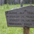 Trail sign at the Stanley Lake Creek and Alpine Way junction.- Stanley Lake Creek + Lady Face Falls