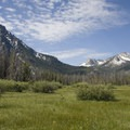 Beautiful meadow views up Stanley Lake Creek Canyon. McGown peak is on the left.- Stanley Lake Creek + Lady Face Falls