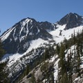 Views of Peak 10,084 (middle) from the unofficial trail to Goat Lake.- Goat Lake via the Alpine Way Trail