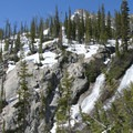 Hikers can scramble to a granite overlook in order to get a view of the Goat Creek Falls.- Goat Lake via the Alpine Way Trail