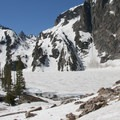 Goat Creek Lake on July 2. Thompson Peak stands in the notch center left of the photo.- Goat Lake via the Alpine Way Trail