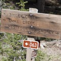 "Trail sign at the first junction near the head of Smiley Creek.- Smiley Creek to Big Smoky ""Loop"""