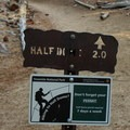 Half Dome trail sign. Permits are required to climb Half Dome.- Half Dome Hike via John Muir Trail