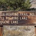 "The lower Hell Roaring ""trailhead"" consists of a simple mileage sign and a small parking area.- Hell Roaring Lake"