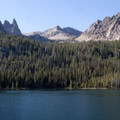The Finger of Fate towers above the north shore of Hell Roaring Lake.- Hell Roaring Lake