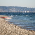 A kayak rests along the beach at Cutts Island.- Cutts Island Sea Kayaking