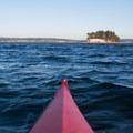 A kayaker approaches Cutts Island.- Cutts Island Sea Kayaking