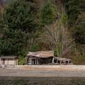 Abandoned buildings along the shoreline of Fox Island.- Fox Island Sea Kayaking