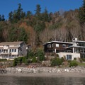 Houses and private property line most of the coastline of Fox Island.- Fox Island Sea Kayaking