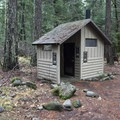 Vault restroom at Trout Lake Creek Campground.- Trout Lake Creek Campground