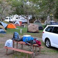 Car-side tent camping.- Keough's Hot Springs Campground