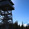 The lookout with Mount Hood (11,249') in the sunshine.- Flag Point Fire Lookout