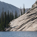 Smooth granite slabs and alpine blue. An unnamed lake above and to the west of Imogene Lake.- Imogene Lake + Divide