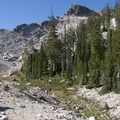 Climbing toward the switchbacks below Imogene Divide.- Imogene Lake + Divide