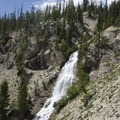 The off-trail route up to Hansen Lakes climbs to the right of Bridal Veil Falls.- Stanley Lake Creek to Hansen Lakes