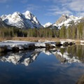 Horstmann Peak (left) reflected in the still waters of Fishook Creek.- Sawtooth Mountains + Sawtooth Wilderness
