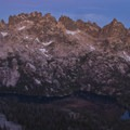 Alpenglow lights up Monte Verita and Big Baron Spire above Baron Lake.- Sawtooth Mountains + Sawtooth Wilderness