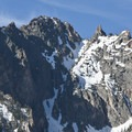 """The north face of the Grand Mogul. The couloir splitting the face is called the """"Boy Scout Couloir.""""- Redfish Lake Loop, Grand Mogul Trail to Bench Lakes"""