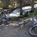 Just before the end of the ride at the Fishook Trailhead a short spur trail leads down to Fishook Creek and this old bridge.- Redfish Lake Loop, Grand Mogul Trail to Bench Lakes