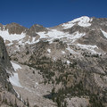 Huckleberry Creek offers an alternate access to the Decker Creek drainage. The Huckleberry Wall (left) and Cramer Peak (skyline right) are destinations in this basin.- Huckleberry Creek