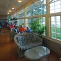 Sun deck and restaurant at Lake Crescent Lodge.- Lake Crescent Lodge