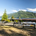 View of Lake Crescent and Mount Storm King (4,525') and the main lodge at Log Cabin Resort.- Log Cabin Resort