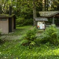 Lyre River Campground picnic shelter and vault toilet facility.- Lyre River Campground