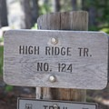 Trail sign at the start of the High Ridge Trail.- High Ridge Trail