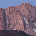 Alpenglow on the walls above Goat Lake.- Broad Canyon: Betty, Goat + Baptie Lakes and the Surprise Valley Divide