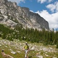 As the trail climbs higher the canyon walls steepen into sheer and vertical granite cliffs.- Broad Canyon: Betty, Goat + Baptie Lakes and the Surprise Valley Divide