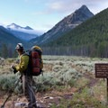 A hiker contemplates the view at the junction with the Left Fork of Fall Creek.- Fall Creek Canyon Hike