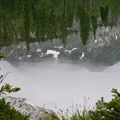 Reflection of mist-shrouded peaks in the still waters of Moose Lake.- Fall Creek - Moose Lake