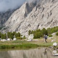 Walking the edge of the uppermost lake in Surprise Valley.- Fall Creek - Surprise Valley, Broad Canyon Divide