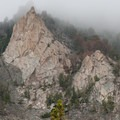 Clouds drift over granite towers on this rainy day.- Fall Creek - Surprise Valley, Broad Canyon Divide